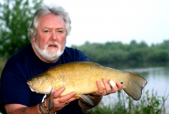 Bailiff Peter Tuke with a near 7lb Tench during a carp session on the Abbots Salford Lake 2013.