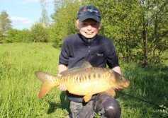 Young Hayden with a stunning 12lb mirror stalked in the margins on breadflake from Alvechurch 2 - Summer 2013.
