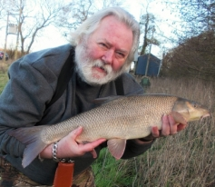 Bailiff Peter Tuke with a 6lb 14oz Barbel from the Avon 26TH Jan 2016.