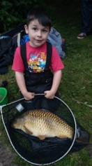 Young superstar Callum Heath with a 10lb common,part of a 24lb catch that put him in 3rd place on the junior match fished at Skilts pool on Sunday 15th June 14.