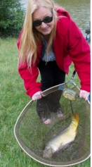 Guest angler Betsy,with a nice mirror stalked on freelined luncheon meat from our Bradley Green venue on 20/08/14.