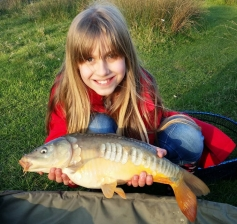 Harmonie, daughter of club member Aaron (Azz) Newitt with a plump carp wich fell to ledgered maggot at Alvechurch pool. 14/04/14.