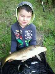 Young Callum with a 6lb plus carp taken in a mixed bag from Skilts pool. 2013.